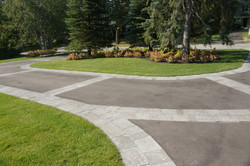 Asphalt and pavers driveway