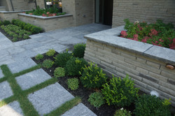 Paver etrance with stone planters