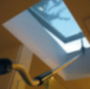 Operable-skylight-being-opened-with-hand