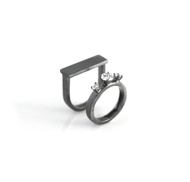 Made with customer's diamonds inherited from her mother. Black rhodium plated for the black finish.