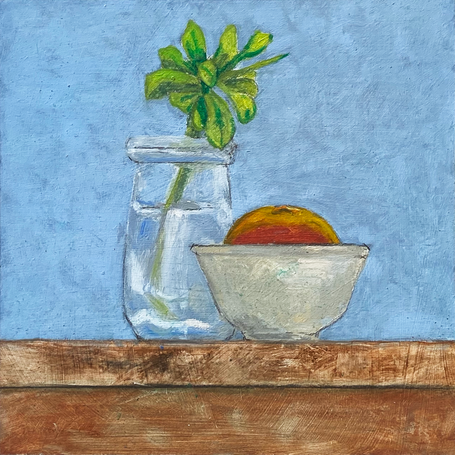 Little jar with succulent and mandarin
