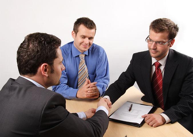Canva - business men negotiating and sig
