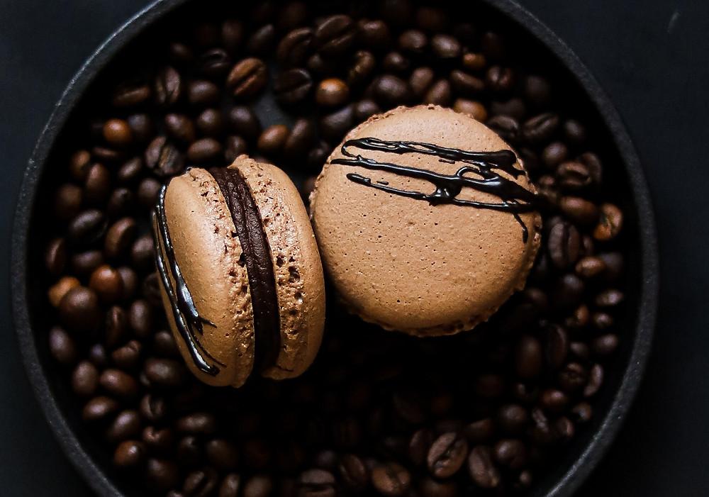 Chocolate macarons with sated bitter chocolate ganache