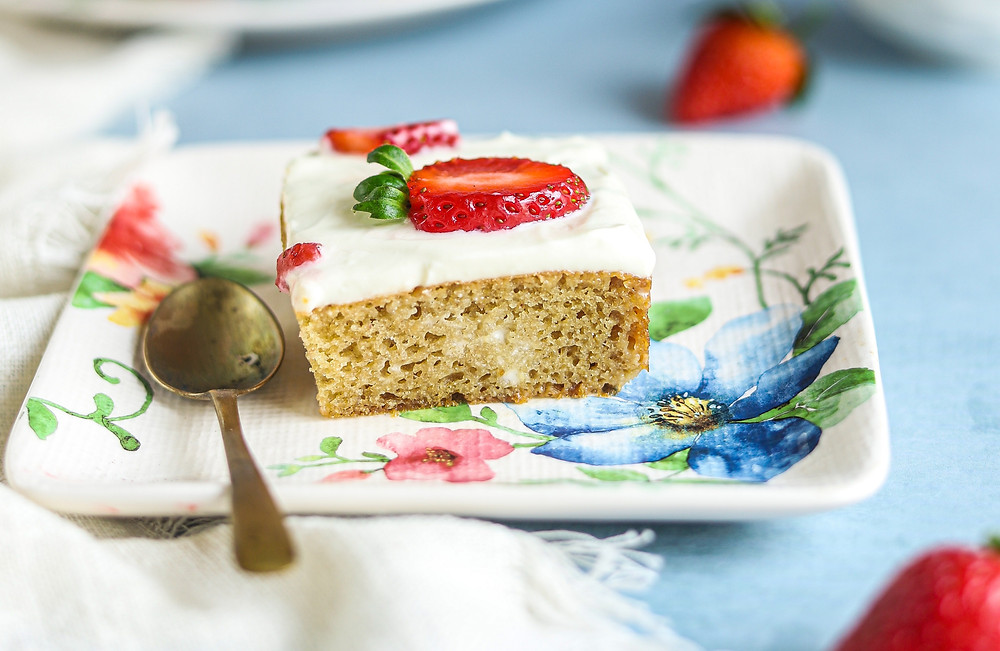 A slice of GF Coconut Almond cake