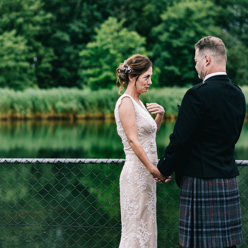 bride-and-groom-near-water-Blank-and-Bur
