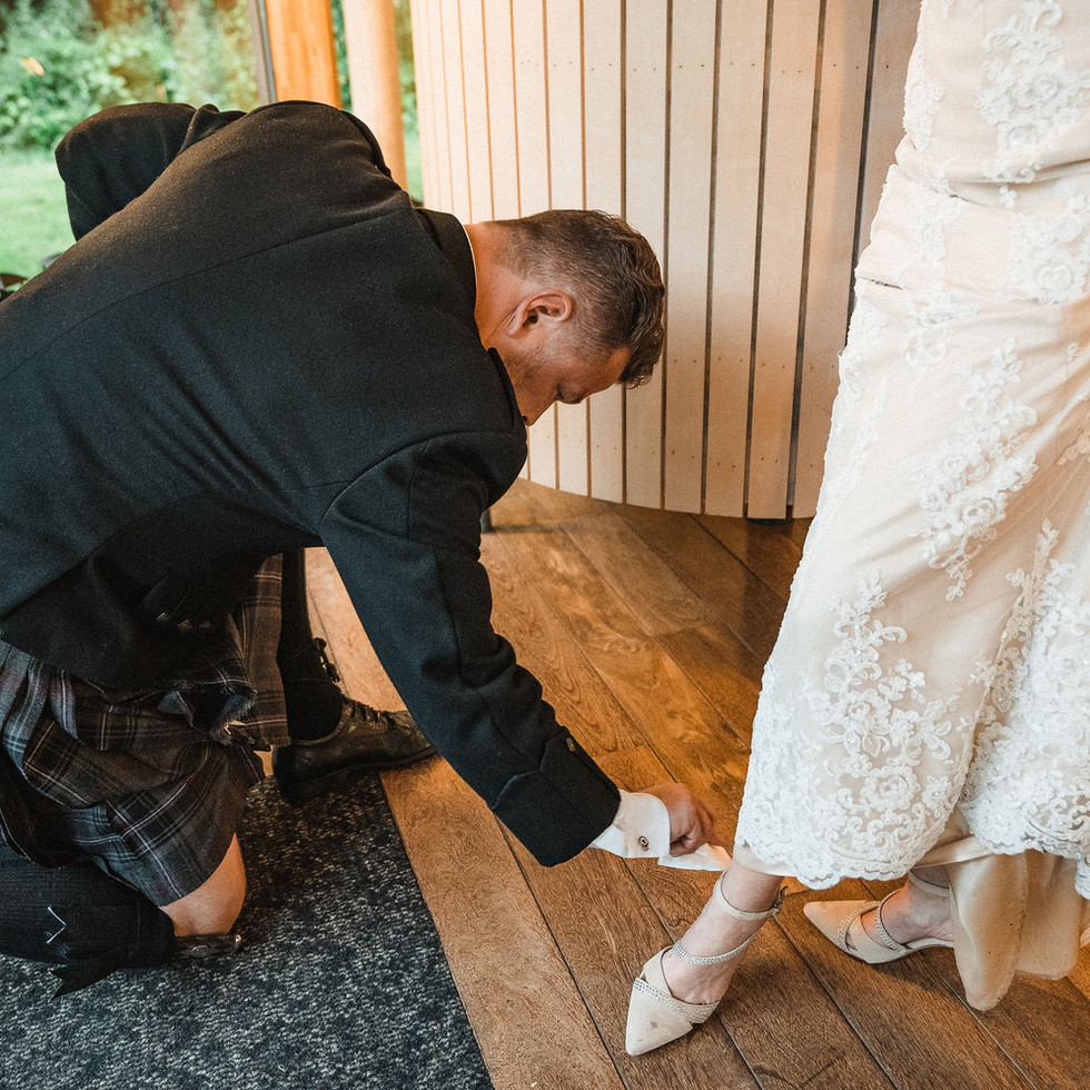 groom-cleaning-shoes-bride-blank-and-burnet-photography