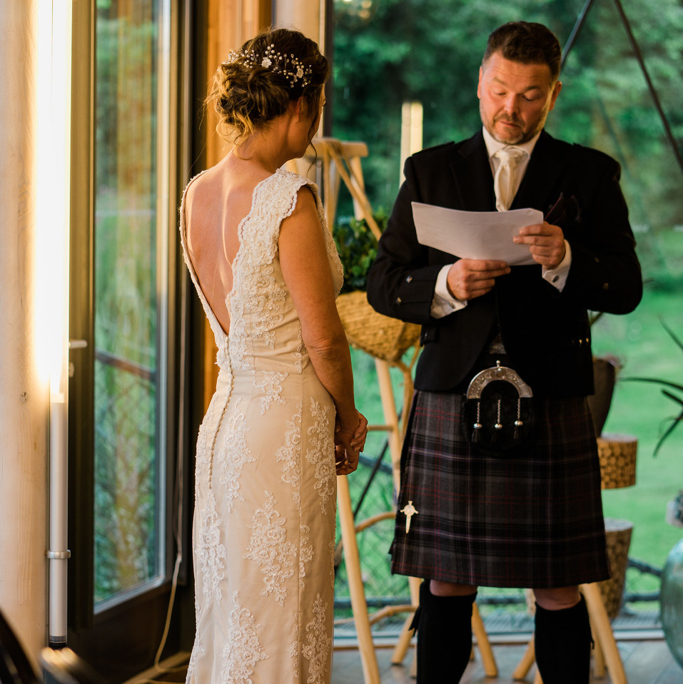 Groom-reading-vows-Blank-and-Burnet-Photography