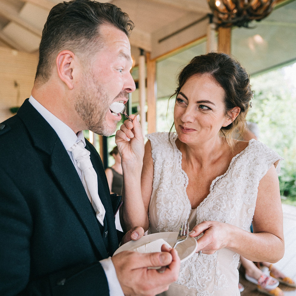 wedding-cake-fun-bride-and-groom-Blank-and-Burnet-Photography