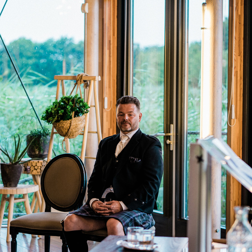 Groom-sitting-waiting-for-his-bride-Blank-and-Burnet-Photography