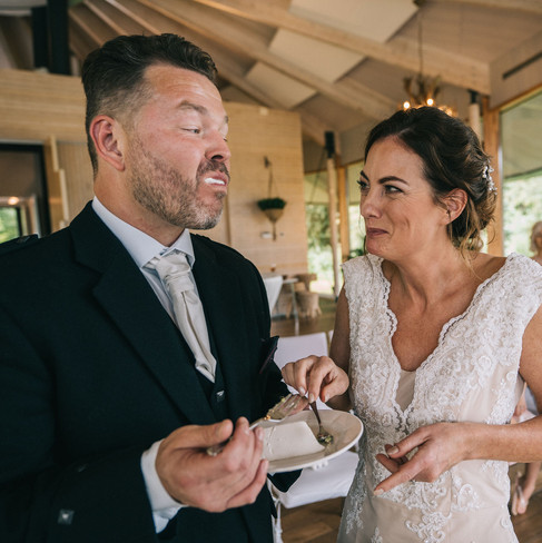 laughing-wedding-cake-eating-moments-Blank-and-Burnet-Photography