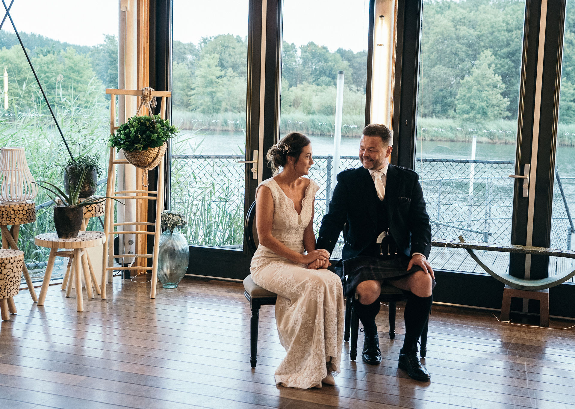 Bride-and-groom-sitting-at-ceremonie-Blank-and-Burnet-Photography
