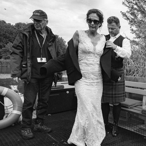 gentleman-groom-helping-bride-blank-and-burnet-photography