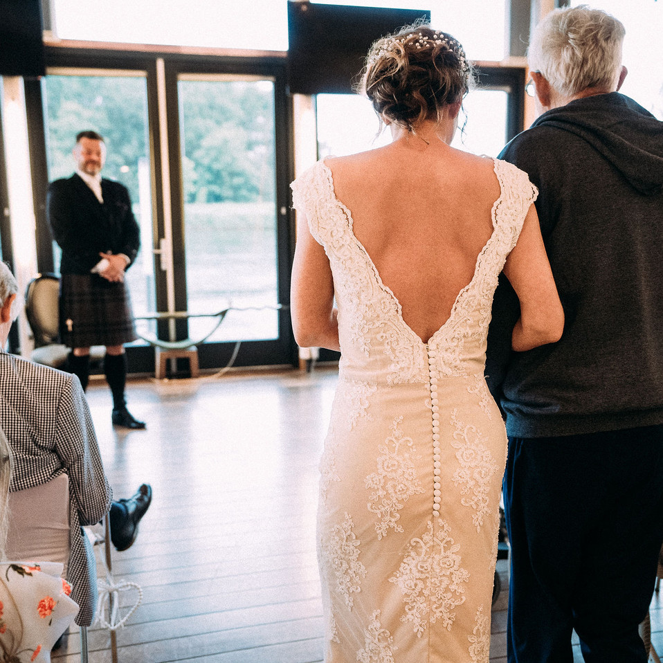 Bride-walking-to-the-altar-Blank-and-Burnet-Photography