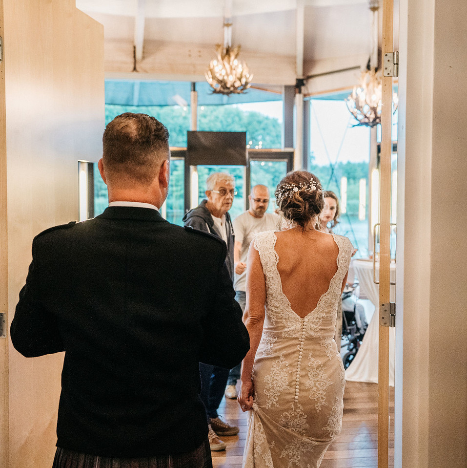 bridal-couple-entering-the-party-blank-and-burnet-photography