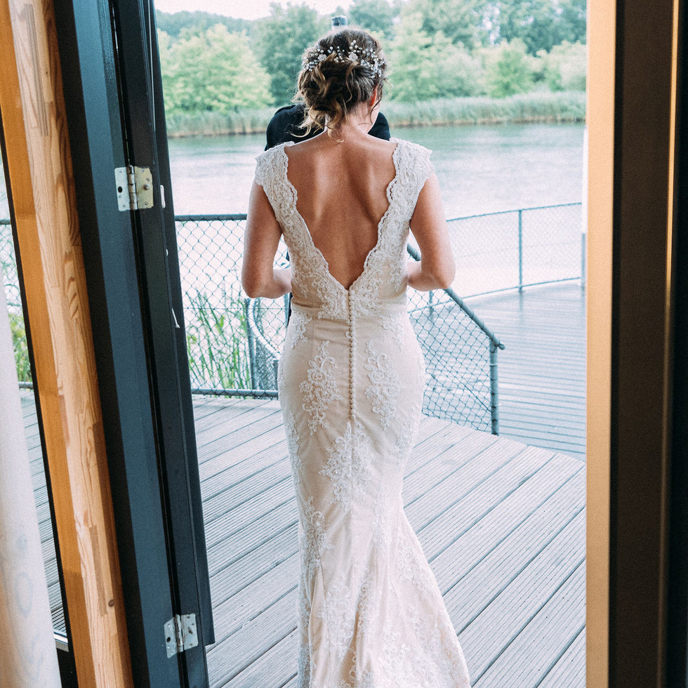 Bridal-dress-standing-in-door-opening-blank-and-burnet-photography