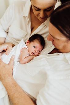 New father cuddling baby boy