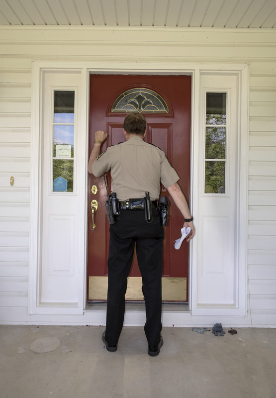 What Should I Do If Police Come to My House With a Search Warrant?