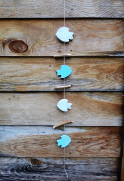 wooden fish and driftwood garland