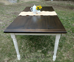 Dining table with painted base