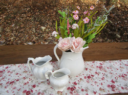 Ironstone pitchers with paper roses