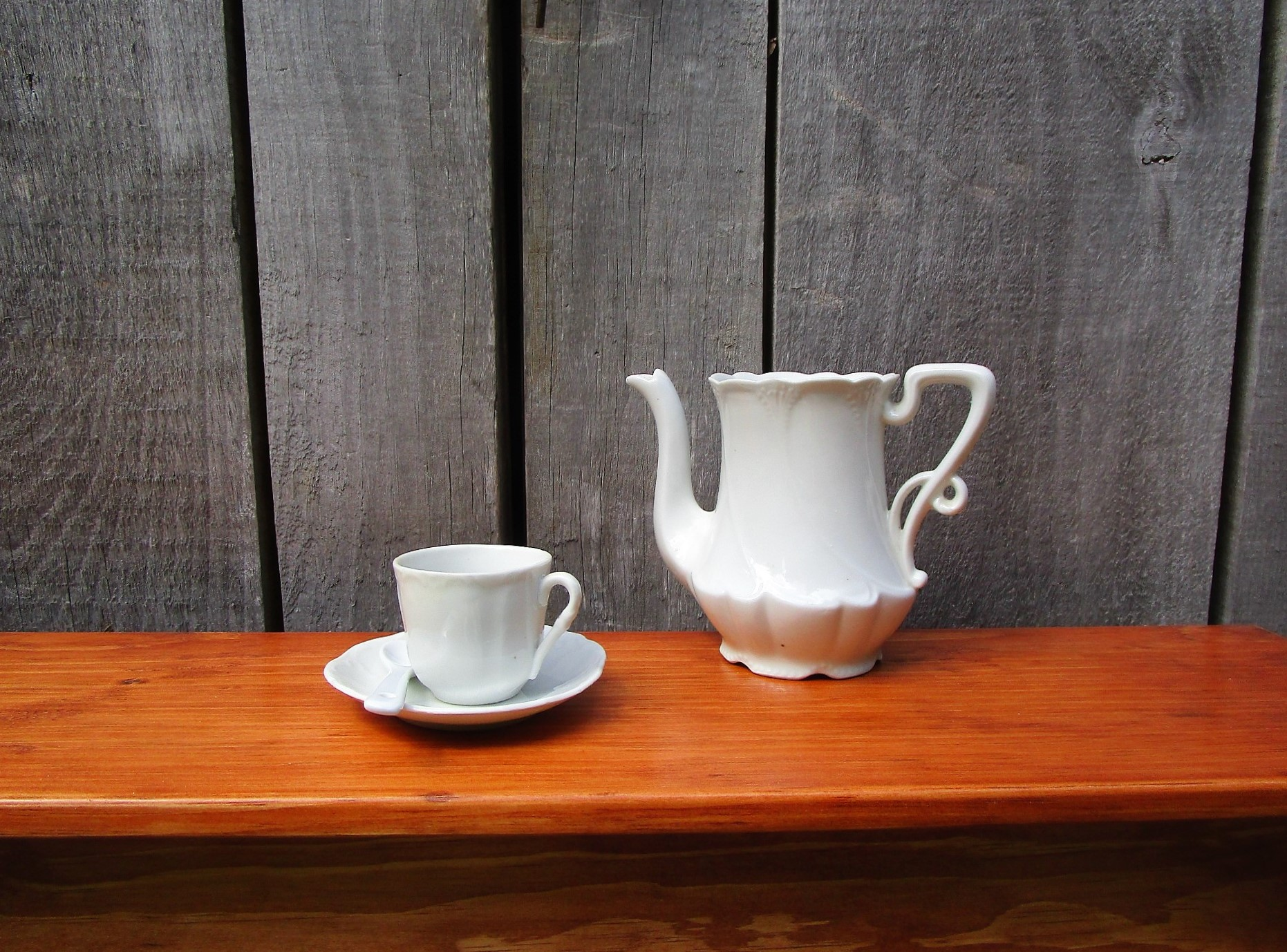 Ironstone coffee pot with cup and saucer