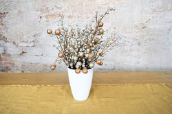 silver and gold in white vase