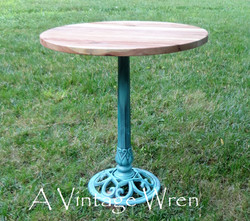 Accent table with cast iron base