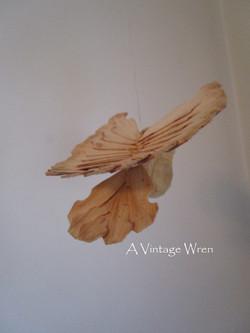 hand craved fan bird
