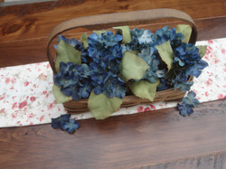 Wood basket with hydrangea