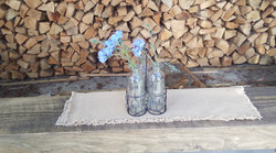 Glass vase with blue flowers