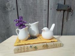 Ironstone pitchers and white ceramic bird