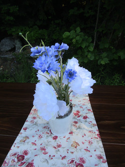Ironstone vase with blue and white flowers