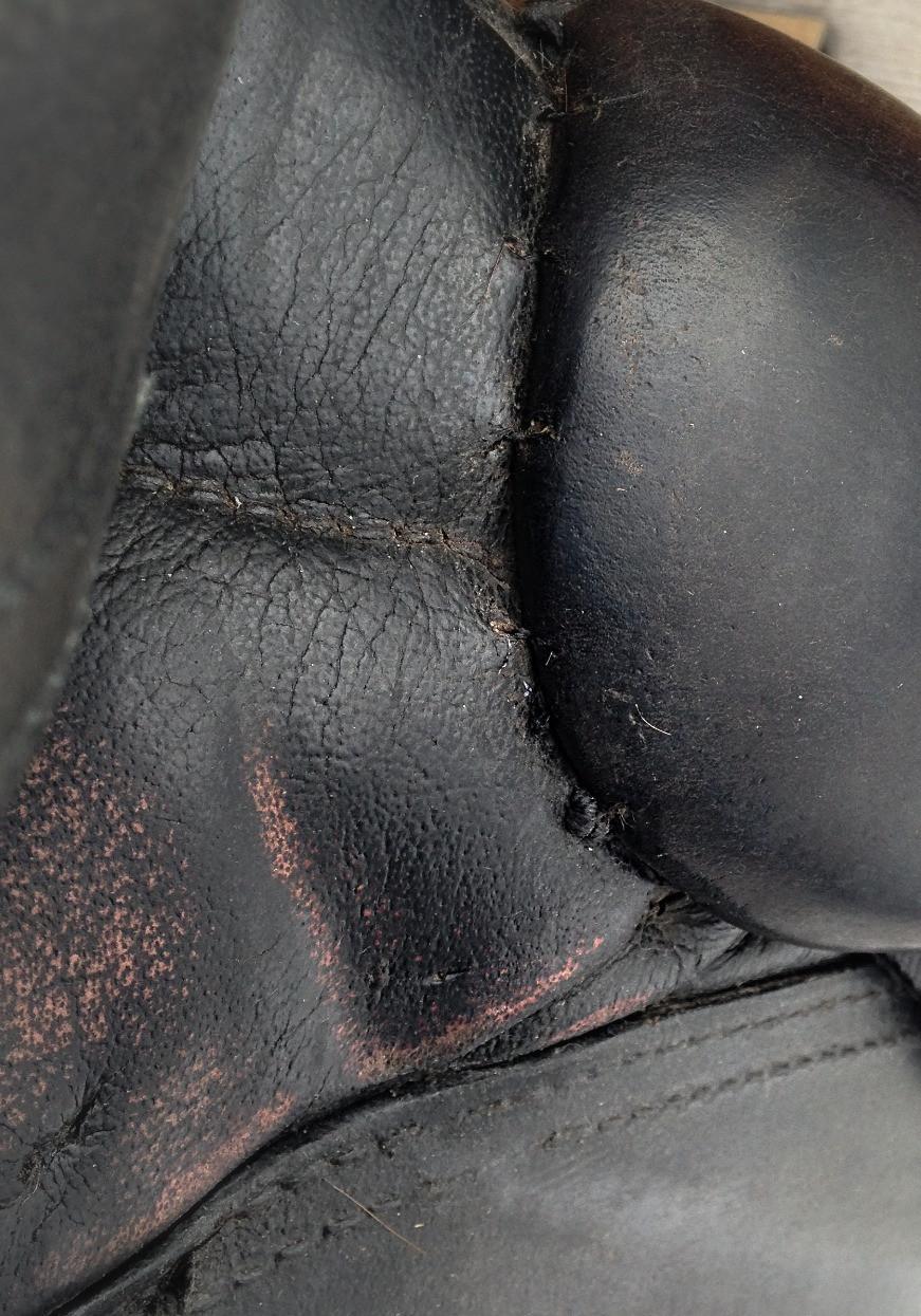 Repaired stitching on thigh block.