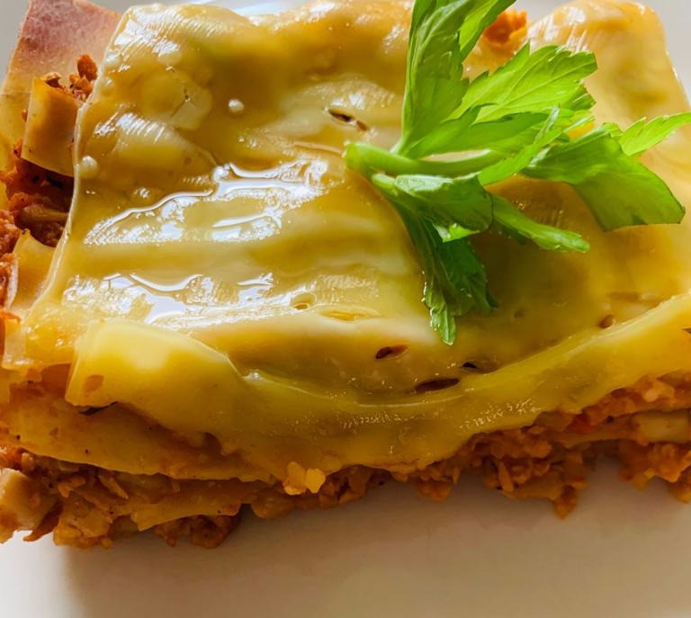 Vegan italian lasagna recipe made with granulated soy