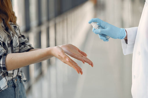 doctor-sprays-antiseptic-patient-s-hands
