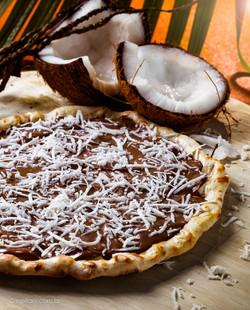 Pizza de chocolate com cocô