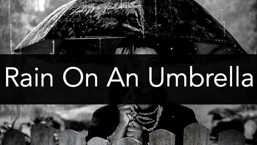 Rain Falling On An Umbrella