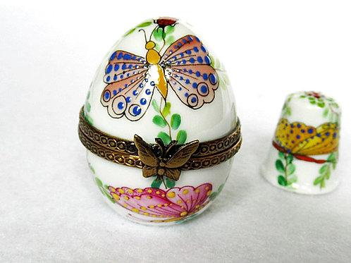 Limoges porcelain mini egg witha timble