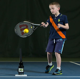 Boy practicing with the tennis Hit Zone air tee!