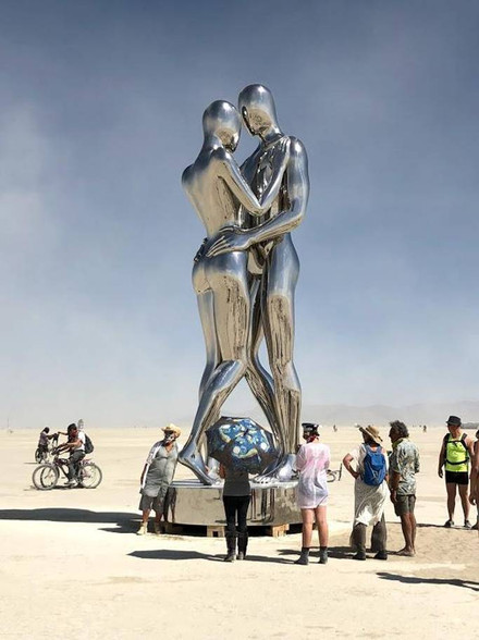 This embracing metal couple dazzled - literally. Its intricately curved surface meant the beating sun bounced off in every direction.
