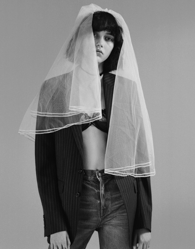 Jacket and Jeans by Celine by Hedi Slimane. Bra by La Perla. Veil by Atelier Emelia. Ring by Cartier.