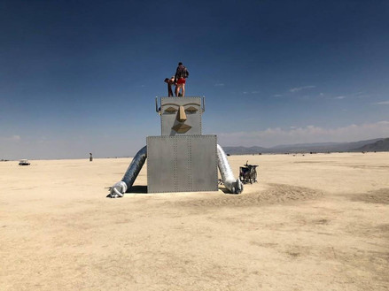 """In keeping with this year's """"I, Robot"""" theme, this seemingly half-submerged robot appeared on the playa, with eyes closed in apparent contemplation."""