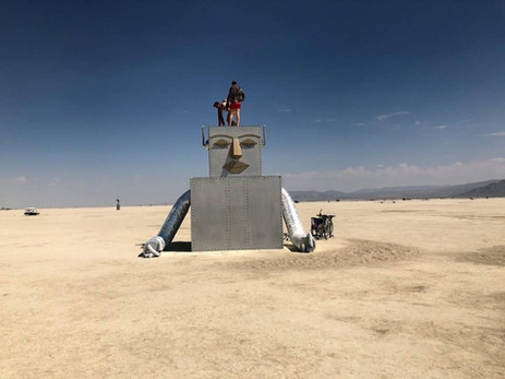 "In keeping with this year's ""I, Robot"" theme, this seemingly half-submerged robot appeared on the playa, with eyes closed in apparent contemplation."