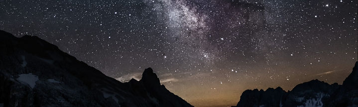 photo-of-mountain-under-starry-night-sky