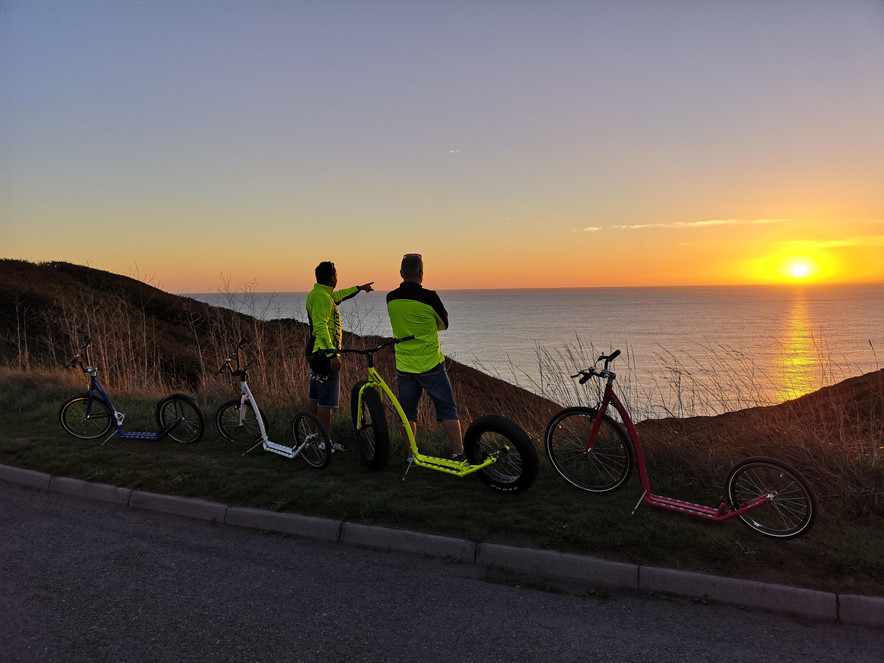 iScootbike premium scooters / footbikes in UK at the sunset