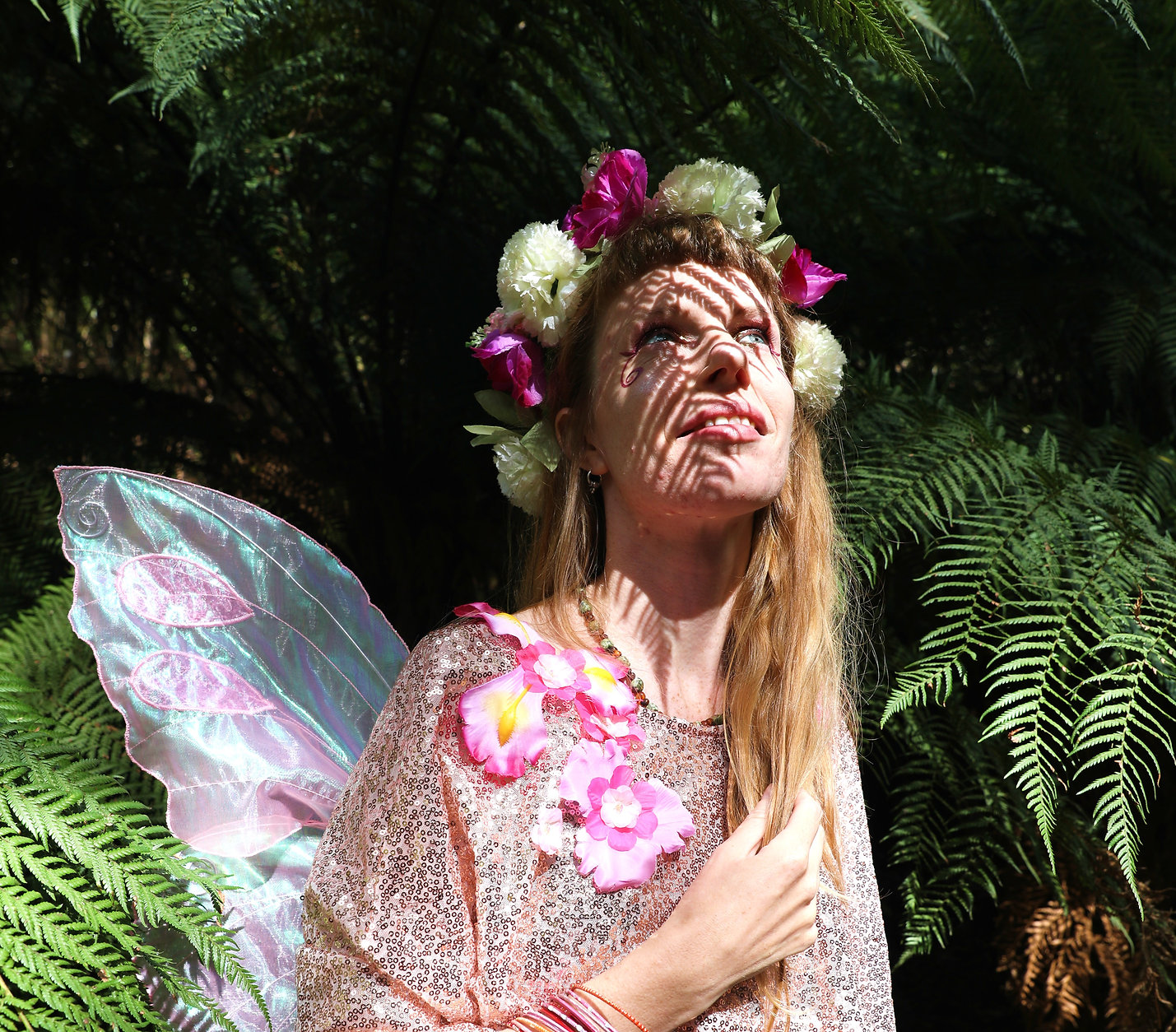 Fairy smiling and looking up in the forest, Faerie Sweetpea
