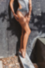 cropped shot of seductive woman in grey