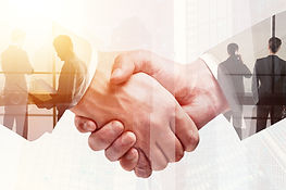 Handshake on abstract city background. Teamwork and meeting concept. Double exposure .jpg