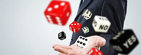 Close up of businessman throwing dice. G