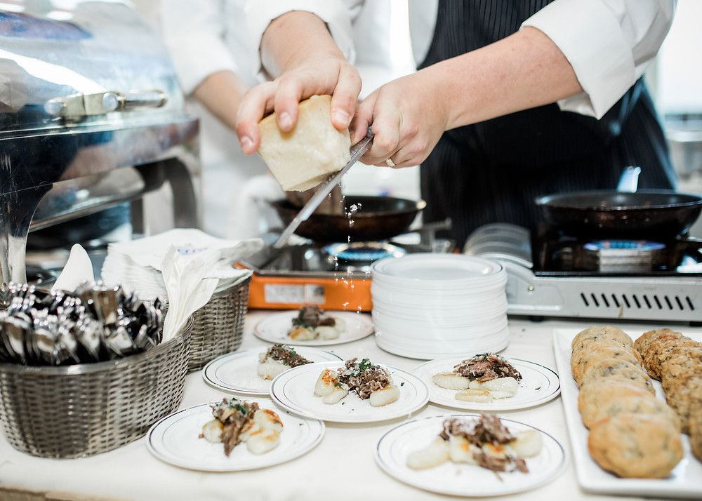 Chef Payne Harding of Cache prepares decadent hors d'oeuvres for Thea Foundation's Blue Plate Special in 2017